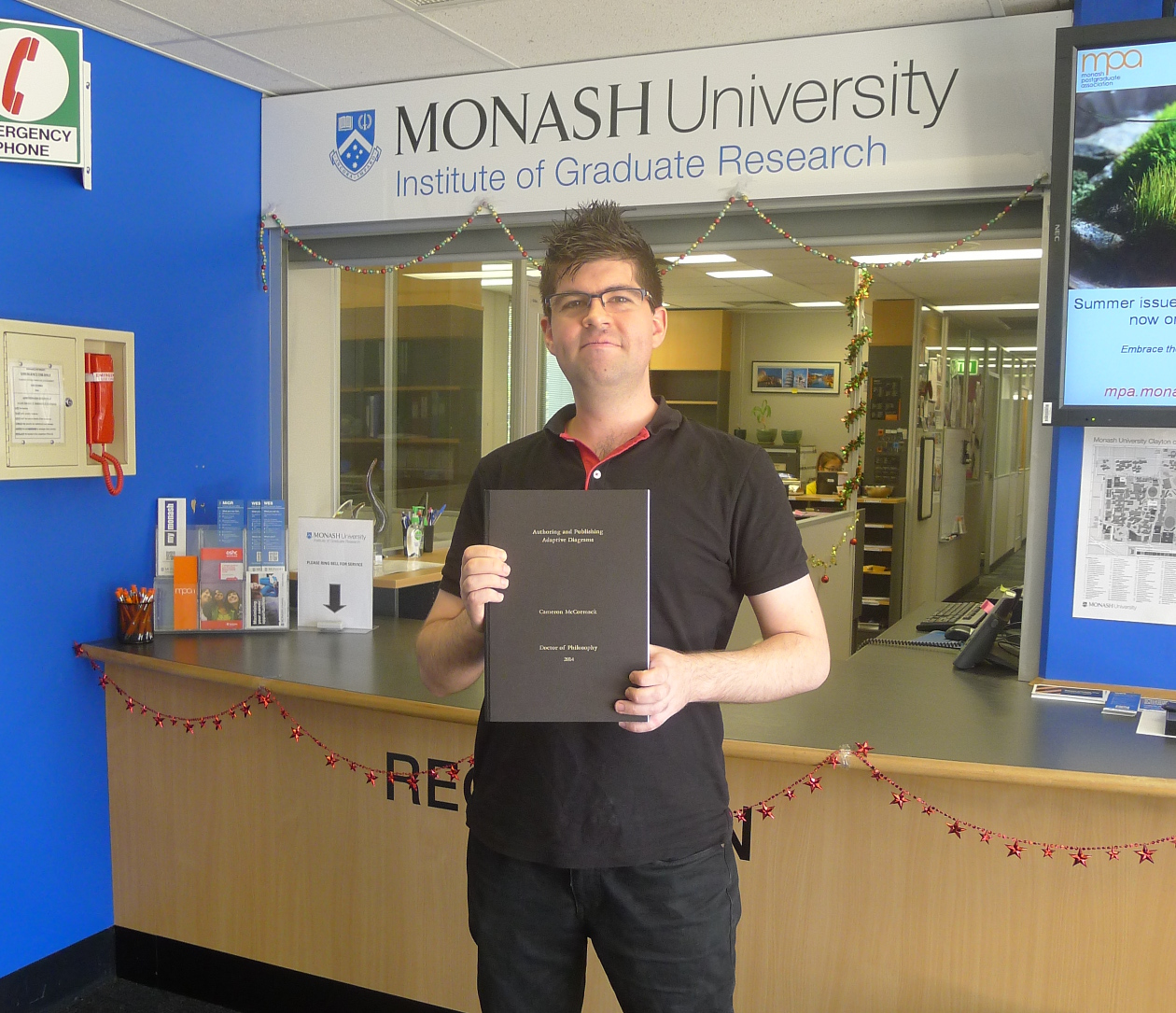 Me submitting my thesis at the Monash Institute of Graduate Research office.